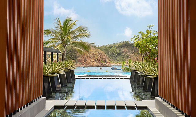 Direct pool and mountain views from Avani Quy Nhon Resort