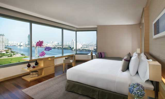 A river view junior suite room at Hotel Riverside Bangkok