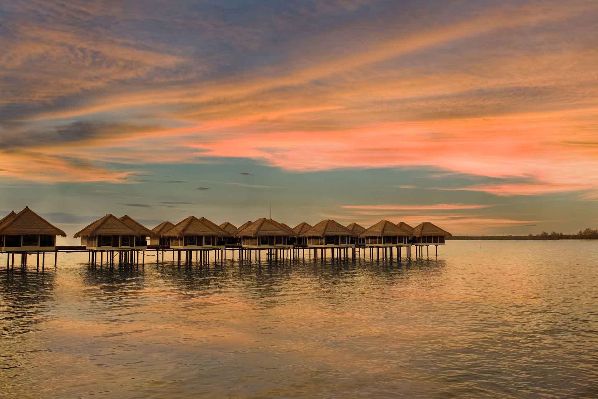 Over water villas of AVANI Sepang at sun set