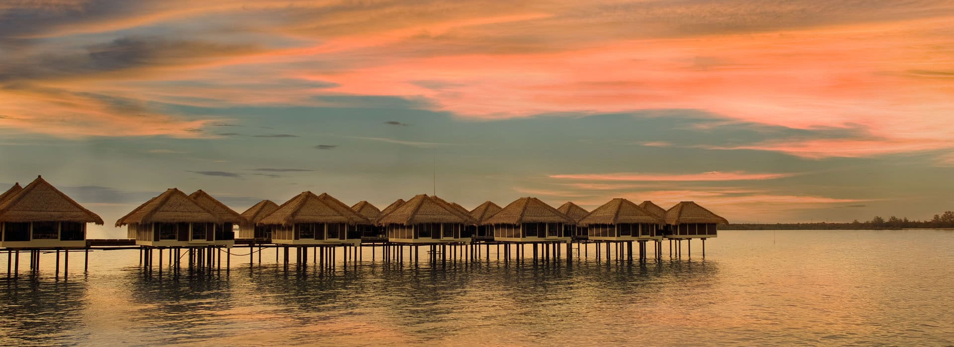 AVANI Sepang Over water villas at Sun set