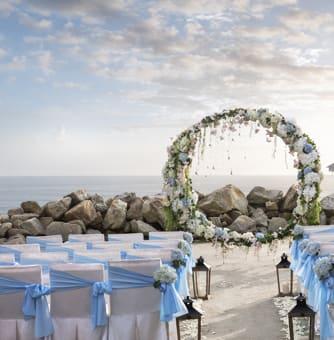 Exterior view of wedding ceremony setup on beach