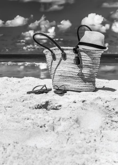 A woven bag on the beach