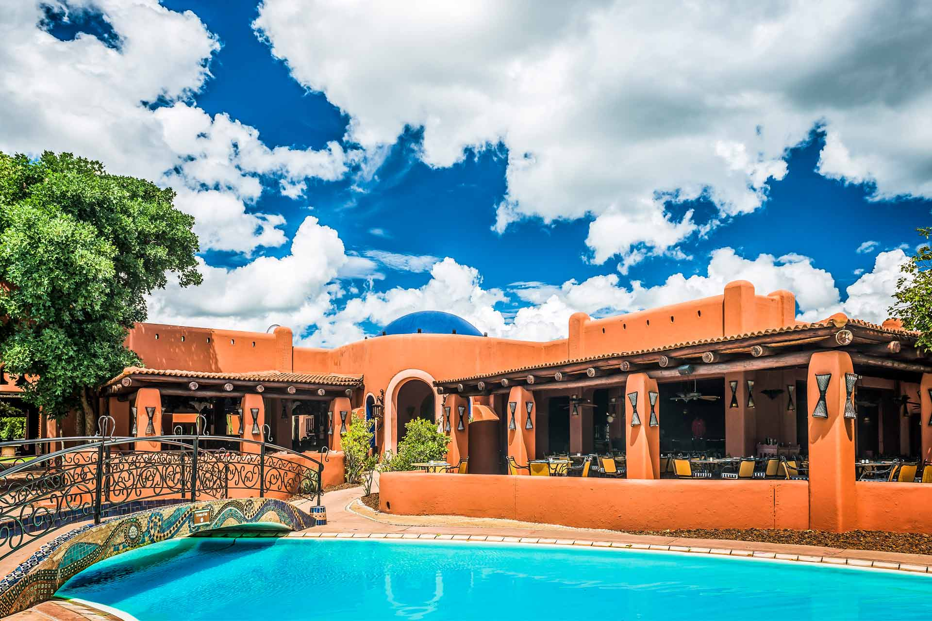 View of the Pool and the Pool Bar at AVANI Victoria Falls