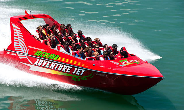 Auckland Adventure Jet Boat going fast in ocean with people